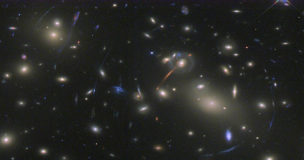 Galaxy Cluster Abell 2813 has so much mass that it acts as a gravitational lens